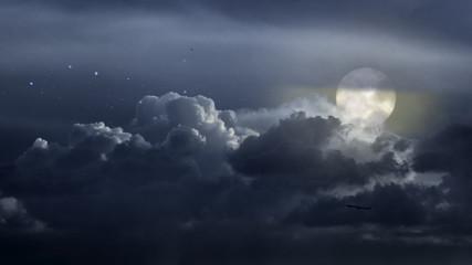 Cloudy full moon night