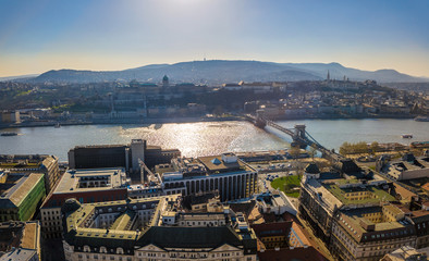 Budapest, Hungary - Aerial panoramic skyline of Budapest with Buda Castle Royal Palace and Szechenyi Chain Bridge at sunset with clear blue sky