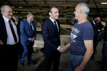 French President Emmanuel Macron visits the Germain-Mougenot sawmill during a day-trip about the wood industry in Saulxures-sur-Moselotte