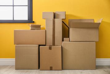 Cardboard boxes on floor indoors
