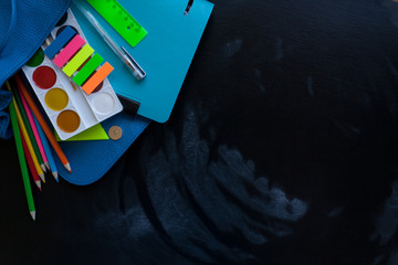 stationery flat lay on black chalkboard