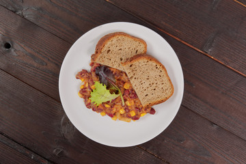 Cowboy beans with bread on a table