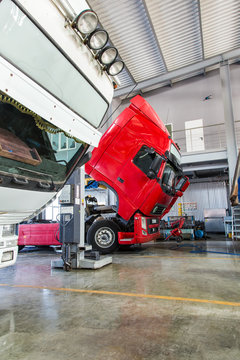 Service maintenance and repair of trucks in a large garage. Tippers and trucks in the hangar. Cargo transportation and logistics
