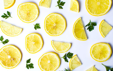 Lemon slices and  parsley leafs on white