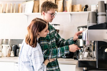 Young couple preparing coffee in the coffee shop