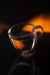 A cup of coffee in transparent glass shot in studio