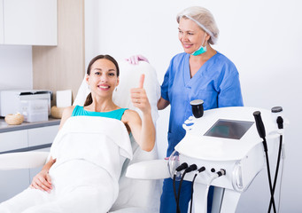Woman satisfied with results of cosmetic procedures