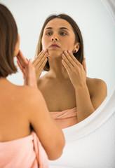 Woman using mirror