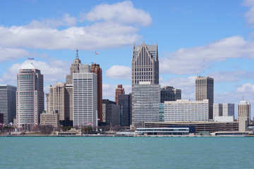 Detroit city center during a beautiful day view from Windsor, Ontario, Canada.