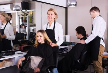 Mature hairdresser working at salon