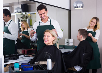 Male hairdresser at the work.