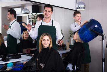 Hairdresser cuts hair at salon