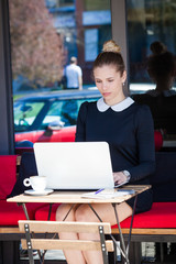 young woman student or business sit in cafe outdoor use  laptop