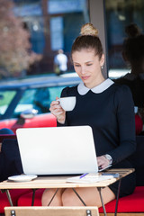 young woman student or business sit and drink coffee in cafe outdoor use  laptop