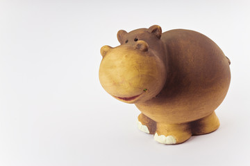 Ceramic hippopotamus toy isolated on white background - image with copy space