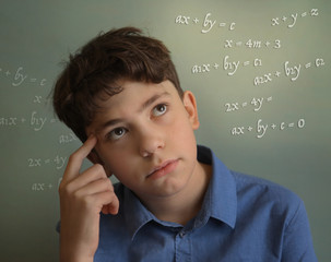 teenager student boy calculating thinking on math equation close up photo