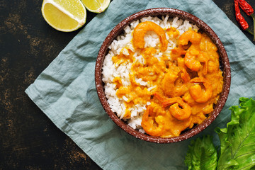 Shrimp in curry sauce with rice.