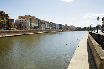 Historical buildings along the river Arno in Pisa