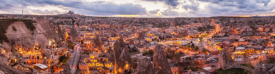 panoramic night view of Goreme and Uchisar on horizon, Cappadocia, Turkey. A world-famous tourist center of balloon flight