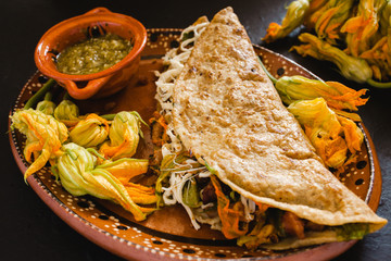 mexican quesadilla with squash blossom, cheese and spicy sauce in mexico city