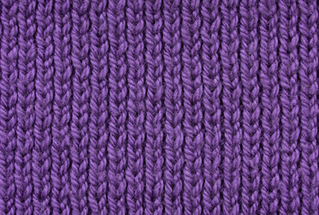 Ultraviolet texture of knitted handmade. Closeup. Wallpaper or abstract background. Pattern.