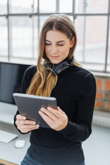 Young woman listening to music browsing for a tune