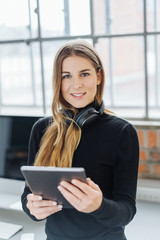 Young smiling woman using digital tablet