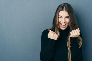 Happy woman wearing black roll neck jumper