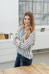 Portrait of young cheerful woman in office