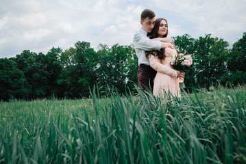 Nice outdoor wedding photography of young beutiful couple in summer park