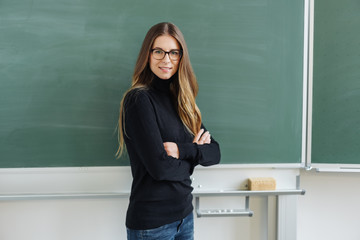 Young woman with glasses against blackboard