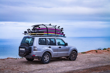 Surfboards mounted on the roof of the car. photo travel. Leisure