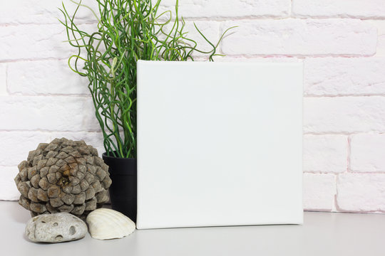 Mock up poster in modern interior. Blank square canvas for design.