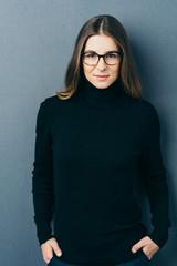 Woman wit glasses wearing black roll neck jumper