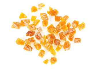 Apricot candied fruits on white background, top view