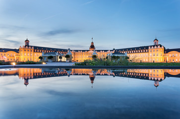 Karlsruhe castle reflected in water in summer evening