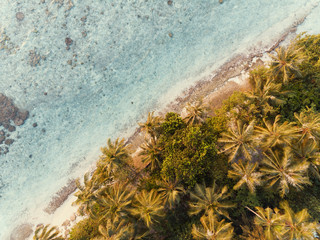 Aerial photo of tropical Maldives beach sunrise