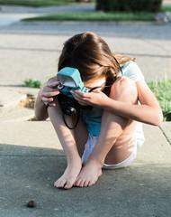 Girl shooting snail