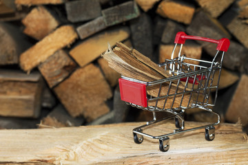 Trade. Wood in a small metal shopping trolley