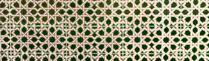 Traditional ornamental Spanish decorative tiles, original ceramic tiles on the walls of buildings