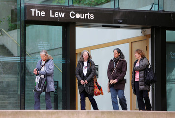 Marie Binet, second to right, walks out of the British Columbia Supreme Court after her court appearance following her arrest on March 22 for protesting Kinder Morgan's Trans Mountain pipeline in Vancouver