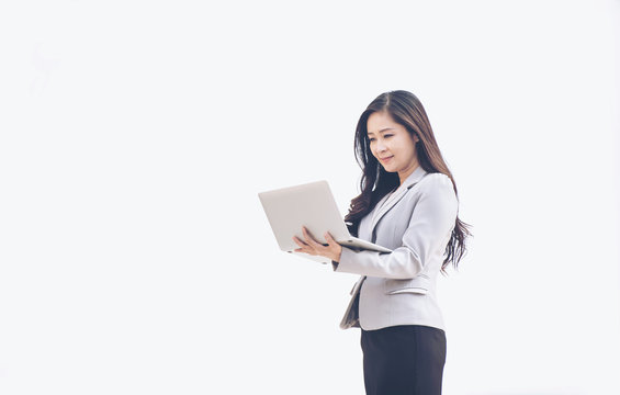 Business woman using laptop computer on white background