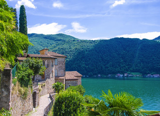 stone houses of the ancient Swiss village Morcote, overlooking Lake Lugano