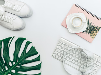 Hipster trendy concept with sneakers, keyboard, headphones and shoes. Flat lay