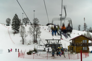skiers and  snowboarders on the ski lift