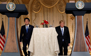 U.S. President Donald Trump and Japan's Prime Minister Shinzo Abe arrive for a joint news conference at Trump's Mar-a-Lago estate in Palm Beach