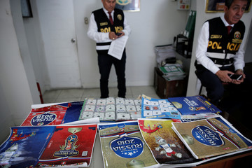 Peruvian police show counterfeit World Cup sticker books seized during a police operation in Lima