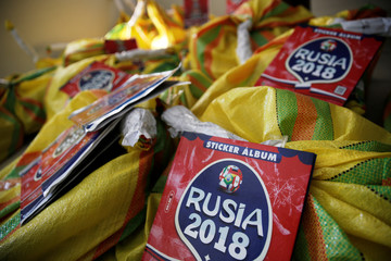 Counterfeit World Cup sticker books are displayed by the Peruvian police after seized during a police operation in Lima, Peru