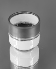Black coffee in a small blue cup
