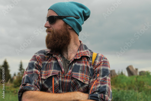 portrait of a bearded male hiker on a trail 5e28b331614e